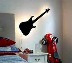 Guitar Lamp for kids room I'm thinking of re-doing a toddler room for my nephew with all his interest...This would be perfect.