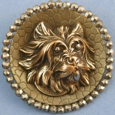 19th C. Scottish Terrier button with cut steels.