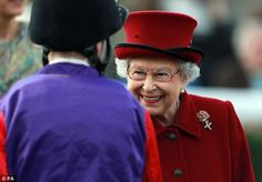 Enjoying herself: Despite his failure to win the race, the Queen appeared to enjoy her chat with David Probert 11th April 2014