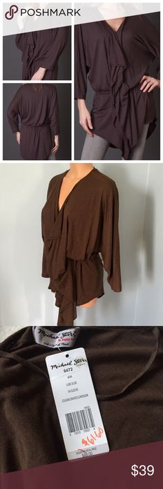 Michael Stars Java Brown Dolman Draped Cardigan OS Luxuriously soft draped dolman cardigan by Michael Stars in luxe slub. Long dolman 3/4 sleeve cardigan features pretty cascade drape and a flattering cinched tie waist. Luxe Slub Micro Modal jersey blend is supremely soft knit fabric with exceptional drape.   New with tags!   Styling Tip: Easy to incorporate any and all of your favorite accessories.   Fit: Oversized Style Michael Stars is available in 'One size fits most', so anyone with…