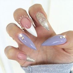 Purple and gold stiletto nails