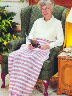 """Deluxe Lap Robe - Delight an older friend with this thoughtful gift -- a lap afghan with pockets for the hands and feet. It's just right for keeping warm! Robe size: 30 x 40"""" (appx)  Skill level: Beginner  Designed by Irene Stock  free pdf from freepatterns.com"""