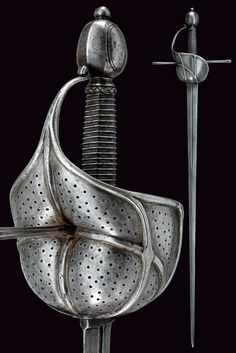 A cup-hilted sword.    provenance: Spain dating: late 17th Century.