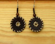 handcrafted leather earrings by Naicurala on Etsy