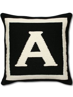 Jonathan Adler Letter Pillows. Hand-loomed in Peru, this cozy pillow is also reversible.