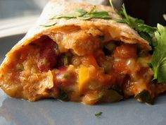 A vegetarian burrito that can be made-ahead and frozen for a quick and easy healthy meal you can grab and eat on the run.