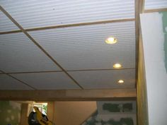 beadboard panel ceiling with trim - if attached with screws would allow for access to wiring & plumbing