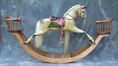 A replica of an F H Ayres rocking horse on a bow, available with or without chairs.    An elegant rocking horse, carved, dappled and tacked up in the original style of F H Ayres horses.