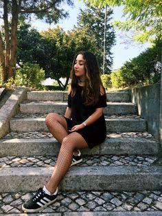 Black cold shoulder dress with fishnets and adidas superstar