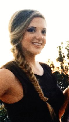 My hair for formal: a messy side fishtail braid with teasing on the top and little curls on the sides