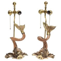 Pair of Hollywood-Regency Style Brass and Horn Dolphin Table Lamps by Chapman | From a unique collection of antique and modern table lamps at https://www.1stdibs.com/furniture/lighting/table-lamps/