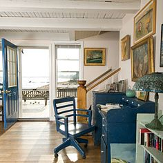 Don't Forget Transitional Spaces - How to Display Art: 25 Creative Ways - Coastal Living Office Nook, Hallway Office, White Hallway, Office Workspace, Coastal Living, Coastal Cottage, Blue Furniture, Diy Wall Decor, Home Decor