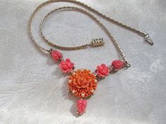 Vintage Coral Peach Rose Flowers Necklace Resin Plastic Carved Celluloid Orange Pearls by FiorellaVintage on Etsy https://www.etsy.com/listing/227172455/vintage-coral-peach-rose-flowers