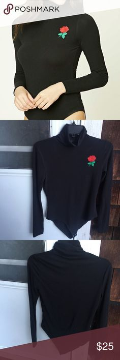 Black Rose Embroidered Turtleneck Bodysuit Not Brandy !   From: forever 21   black turtleneck bodysuit with a rose embroidered on it !   size: small   super cute & comfy !   very aesthetic !   no flaws !    ✨TAGS: Brandy Melville, BM , American Apparel , AA , Urban Outfitters, UO , Topshop , LF , Unif , Tarte , Too Faced , Adidas , Nike‼️MAKE OFFERS THROUGH BUTTON ONLY‼️❌NO TRADES PLEASE❌ Brandy Melville Tops