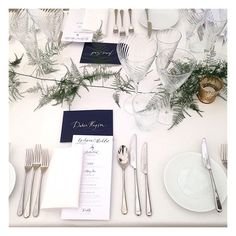Simple and beautiful table decor at an Aynhoe Park wedding. The place cards are actually envelopes full of mini sparklers and glitter. Stunning calligraphy and bespoke stationery by @lamplighterlondon and asparagus fern by @wild_renata_flowers Wedding by Liz Linkleter Event Planning & Design