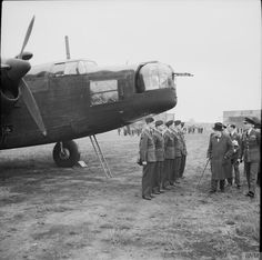 Winston Churchill inspecting a Wellington bomber and its ground crew during a visit to an RAF bomber station, 6 June 1941.