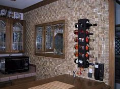 A whole wall in wine corks. Cool backsplash idea for a basement bar. by Pamela Schmitt