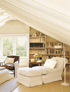 Shelves with books add visual interest to an awkward wall. A comfy chair, table, and lamp complete the place to read.