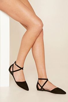A pair of faux suede flats featuring a pointed toe and an ankle strap with buckle closure #stepitup