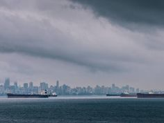 """""""Do you wish to rise? Begin by descending. You plan a tower that will pierce the clouds? Lay first the foundation of humility."""" - Saint Augustine  _  Clouds & ships in Vancouver Canada.  #vancouverisawesome  #explorecanada"""