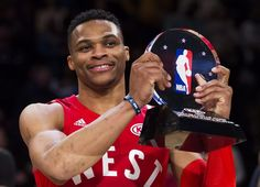 Western Conference's Russell Westbrook, of the Oklahoma City Thunder, hoists the game MVP trophy at the NBA All-Star Game in Toronto on Sunday, Feb. 14, 2016.