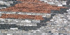 """Wang Shu """"Wa Pan"""" exterior walls; a traditional building technique that uses found material fragments."""