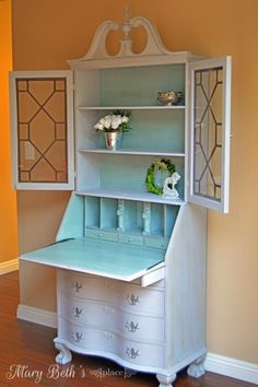 "This vintage secretary desk was refinished in Annie Sloan Chalk Paint. Exterior in ""Paris Grey""; interior ""Duck Egg"". Silver gilding wax completes this transformation."