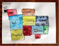 Painting with kids is worth the mess! Color coded mansion design by a child and other fun painting activities.