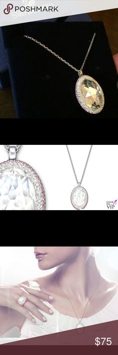 """Stunning Swarovski Crystal Vita Moonlight Pendant NIB 💥Stunning Swarovski Crystal Pendant Necklace. New and still in box and plastic wrapping. The gorgeous center stone is crafted using moonlight crystal and is encircled with hand placed pink toned and clear crystals using swarovski's exclusive pointiage technique. Pendant is 1 x 3/4"""". 💥 Swarovski Jewelry Necklaces"""