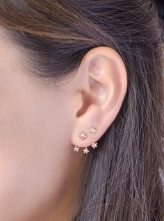 http://sosuperawesome.com/post/163305781302/ear-jackets-and-climbers-and-hugging-earrings-by