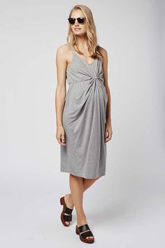 Choose easy shapes for effortless styling during your pregnancy in this knot front dress. Comes in a relaxed midi fit with knotted detail at the front and casual skinny straps. Wear with trainers for ultimate comfort and on-trend style. #Topshop