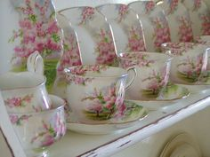 """Royal Albert """"Blossom Time"""" teacups ~ all lined up."""