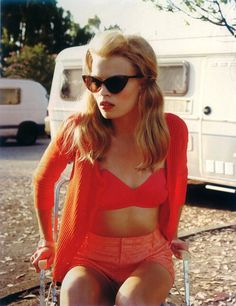 cat eye glasses high waisted shorts and the color of the year peachy-orange-redish color does this ring a bell in 2012 fashion looks like vintage is back :)