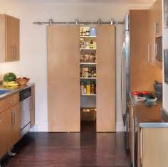 sliding pantry doors Kitchen Farmhouse with barn door beadboard ...