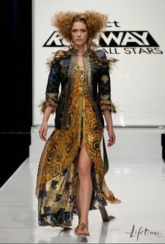 """Project Runway all stars: Episode 7 challenge was to make an outfit for Uzo Aduba in the Broadway musical """"Godspell"""". The winner Mondo Guerra's ~the winning look reminds me of a Pre Raphaelite painting meets a 1970's Yves Saint Laurent meets liquid gold. Absolutely gorgeous and perfect for the part. Bravo!"""