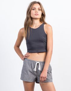 Need a basic tank that you can wear all the time while lasting long? This charcoal Soft Ribbed Crop Tank will be your new favorite go-to piece. Pair this top with some high waisted destroyed denim shorts and ankle booties for a chic model off-duty vibe.