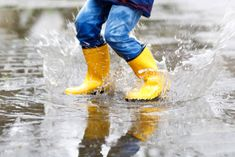 Close-up of kid wearing yellow rain boots and walking during sleet, rain and snow on cold day. Child in colorful fashion casual clothes jumping in a puddle. Having fun outdoors. Hunter Boots Outfit, Hunter Rain Boots, Yellow Rain Boots, Backyard Trampoline, Walking, Fashionable Snow Boots, High Jump, Kits For Kids, Parenting Styles