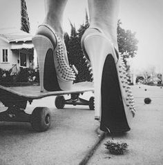 Skatebording in stilletos.....I feel like this represents my personality but i dont know if i'm crazy enough to do it!
