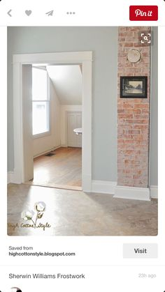 Love the wall color and exposed brick