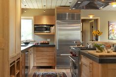 Local woodworker Whit Hart built the custom quartersawn red-oak kitchen cabinets and red-oak countertop.