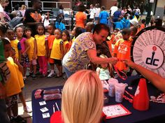 The Washington Mystics/Wizards Promo Squad provided their prizewheel for fans to spin the wheel and win giveaways of Mystics and Wizards gear. (Downtown Silver Spring Reptiles Alive event on July 11th, 2012)