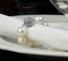 For just the bridal party, get fancy bracelets and use them as napkin rings that they can keep and wear again and again