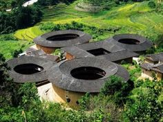 """Fujian Tulou (Hakka rammed earth building) cluster, Fujian province, Southern China. A defensive community, the oldest still standing is  """"Fu Xing Lu"""" in Hu Le; which was built in 800 CE and is a UNESCO World Heritage Site"""