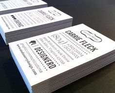 Beautiful letterpressed business cards. Printed on white, then sandwiched with a piece of black paper in the middle.