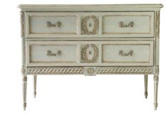 Capturing the look and a feel of a prized antique find, this Gustavian-style dresser is hand-carved of mango wood with a Swedish blue finish, floral molding, and lightly distressed detailing....