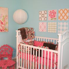 I love the patterned pictures behind the crib - would be an easy DIY project.