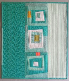Mostly Teal - front ...I like the idea to make plain sides more narrow and add length for a table runner, or make small for placemats; mug rugs could be made to match with a wonky block like center of this.....vwr