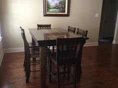 x x H Farmhouse Counter Height Table stained Dark Walnut with a satin finish. Pictured with Henry Counter Height Stools. Pub Table Sets, Dining Table, Stained Table, Counter Height Table, Rustic Solid Wood Dining Table, Counter Table, Durable Table, Farmhouse Table, Home Decor Styles