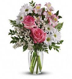 http://ikesflorist.com/farmington-ikes-florist/what-a-treat-bouquet-with-roses.html