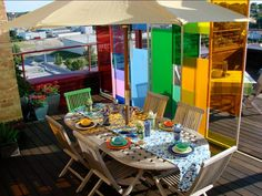 Kaleidoscope Wall For a dramatic outdoor space, a colorful Plexiglas panels are used to divide the space. The panels not only look great, they provide privacy and a little shade. Design by Rate My Space contributor PHLpavilion.